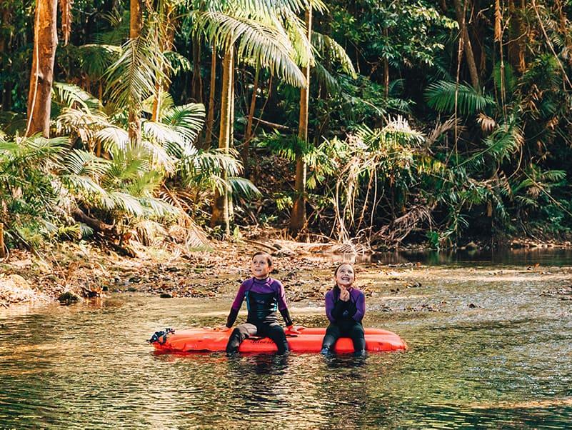 Children floating in the rainforest