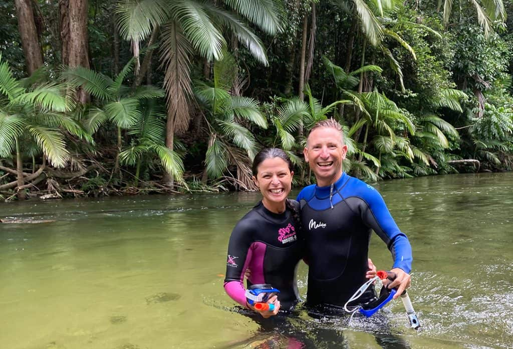 Couple standing in Mossman River Back Country Bliss Adventures